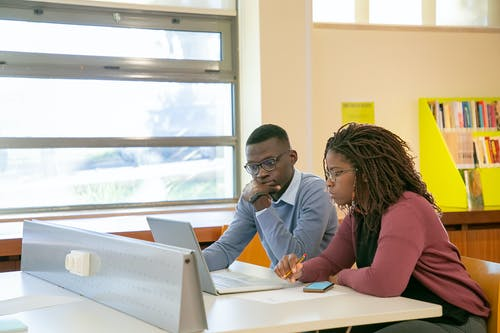 Black couple doing presentation for studies in classroom