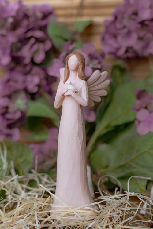 White Angel Ceramic Figurine on Green Grass