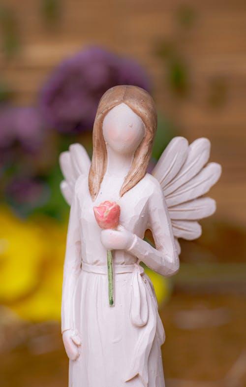 White Angel Figurine in Green Dress