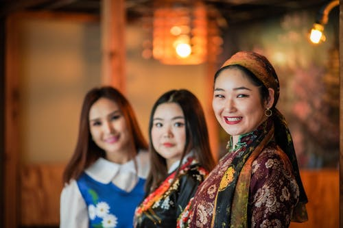 3 Women Smiling in Front of Camera