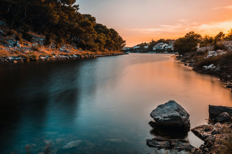 Calm Body of Water Near Land