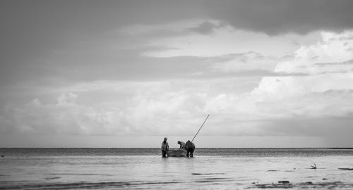 Anglers Standing Beside a Fishing Boat