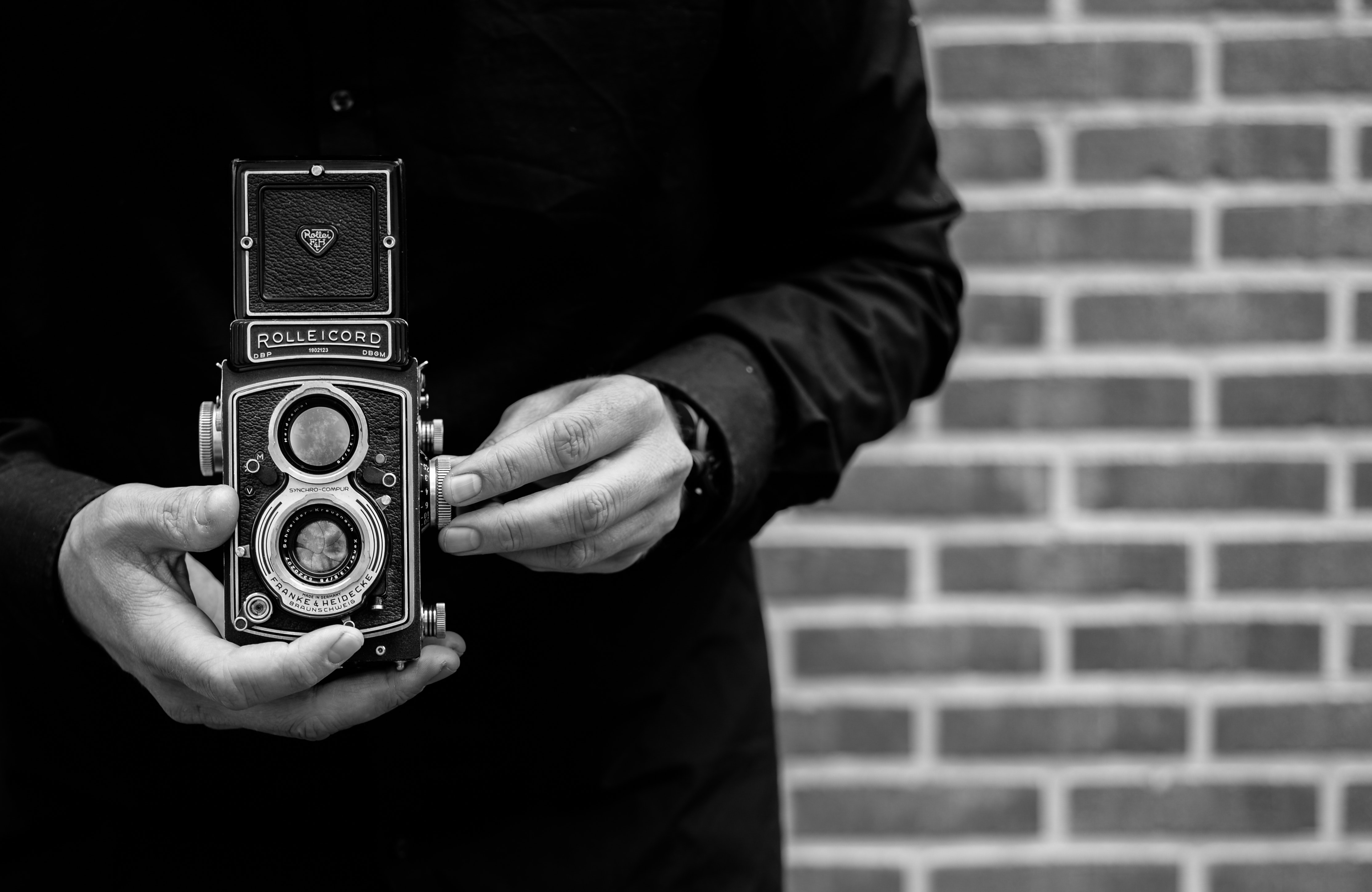Grayscale Photo of Person Holding Vintage Camera · Free ...