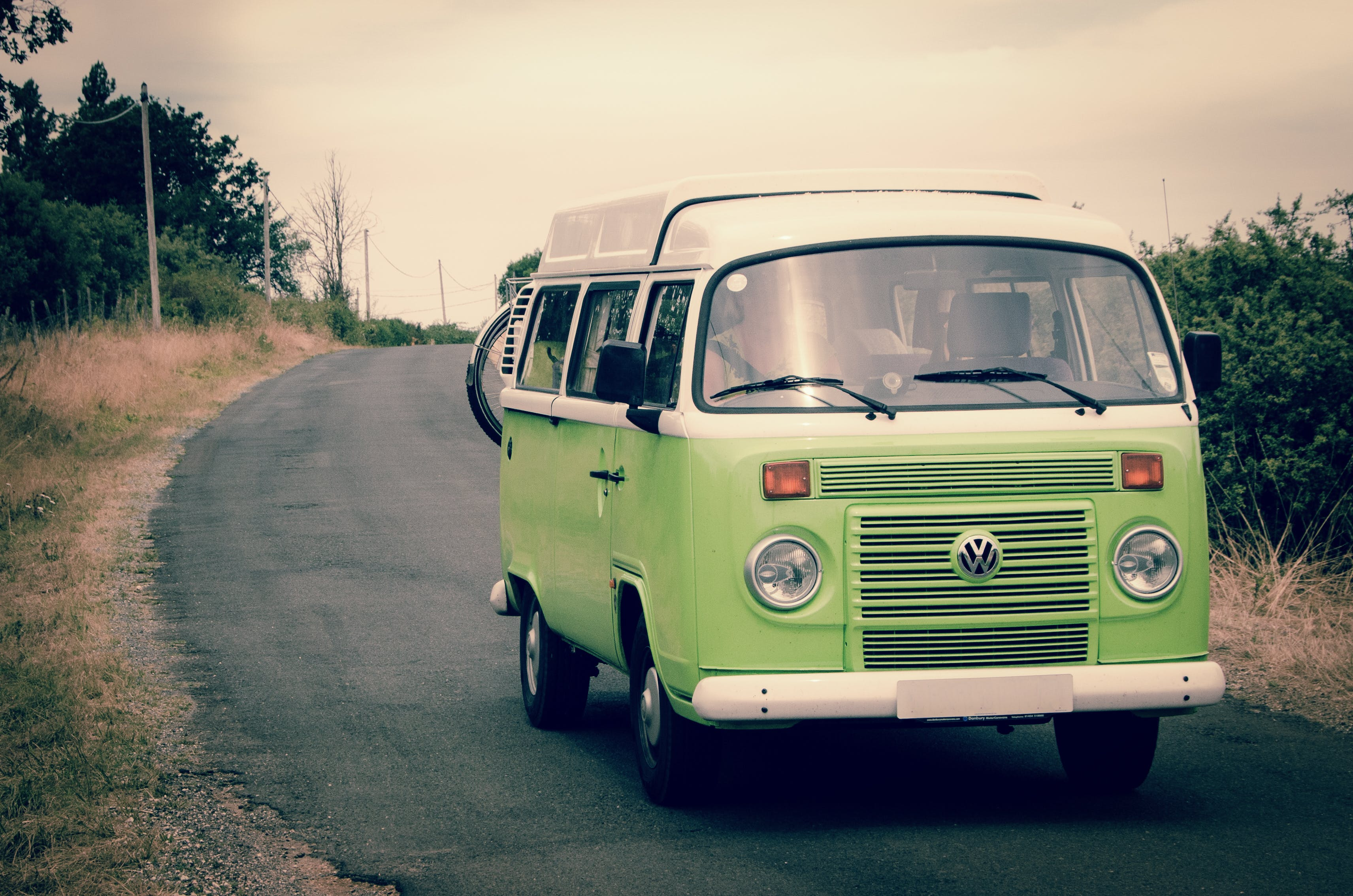 Green and White Volkswagen Combi