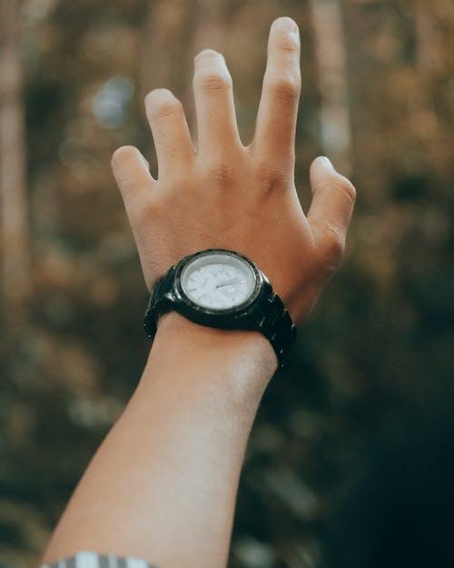 Person Wearing Black Round Analog Watch
