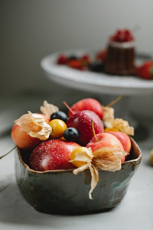 Ripe fruits and berries in bowl