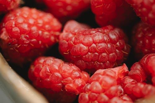 Heap of fresh ripe raspberries in bowl