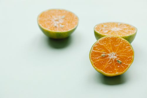 Halves of whole oranges for healthy tropical meal