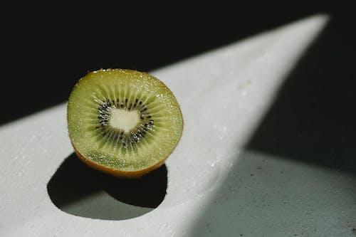 Half of fresh juicy kiwi at sunshine
