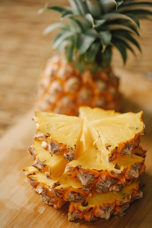 Segments of pineapple arranged on board
