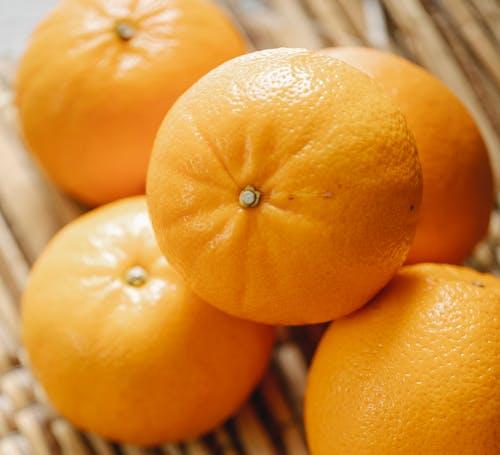 Ripe mandarins on wicker surface