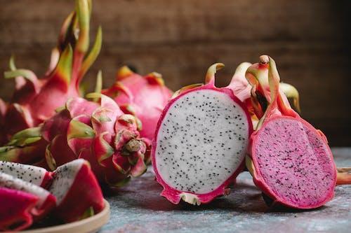 Halved dragon fruit on table