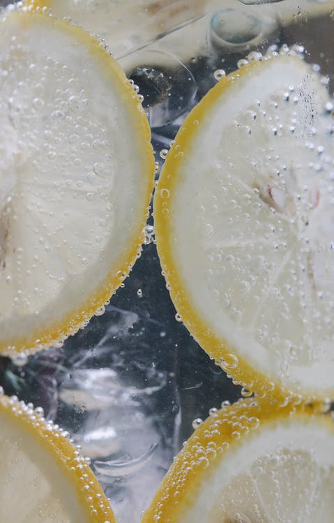 Glass with water and lemon slices