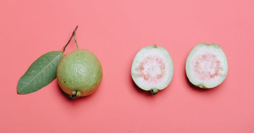Whole and cut guava fruits
