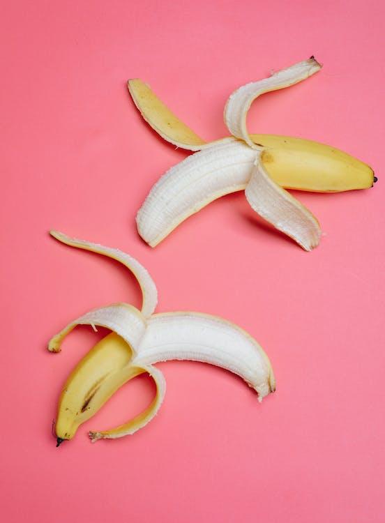 Mellow sweet bananas on pink surface