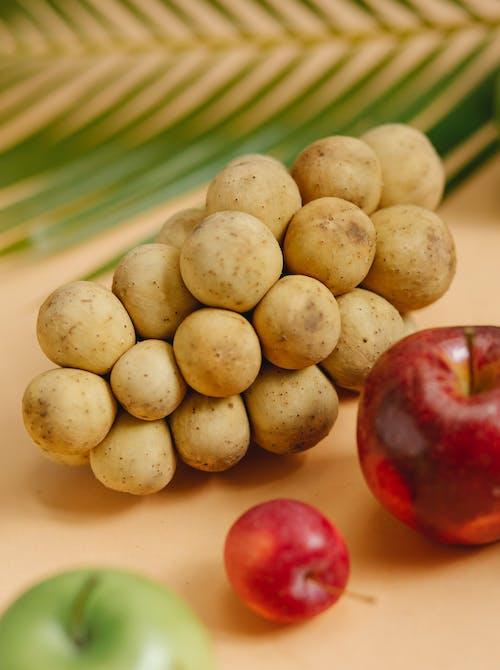 Fresh apples and tropical fruit longkong