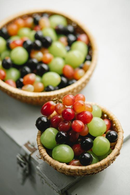 Grapes in wicker bowls in daylight