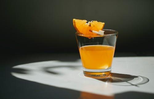 Glass of orange juice with orange slice
