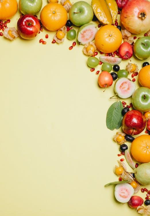 Ripe fresh fruits on beige surface