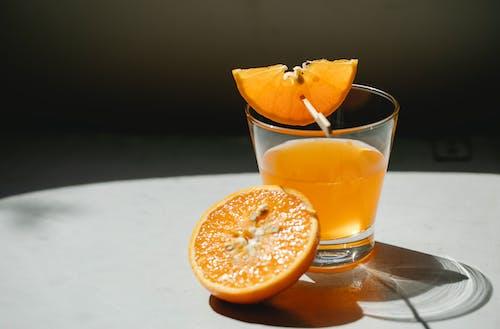 Orange pieces with glass of juice
