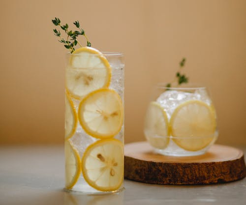 Glasses with lemon drink on table