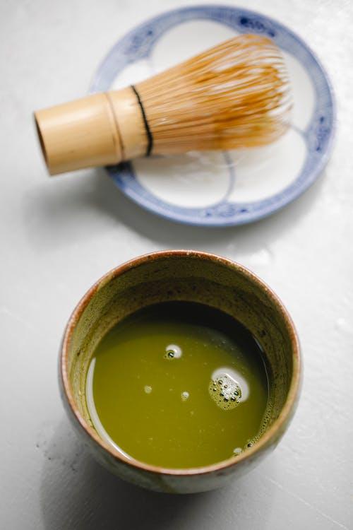 Mixture of green tea in ceramic dishware