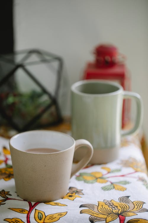 Cups of tea on table at home