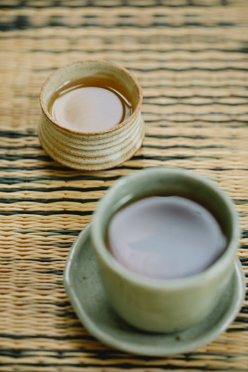 Oriental cups of natural tea on table