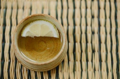 Oriental cup of green tea on straw mat