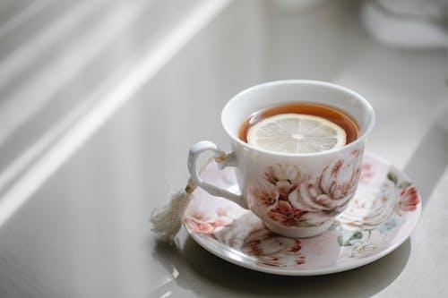 Elegant cup of hot tea with lemon