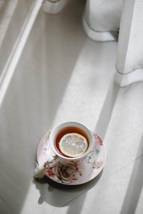 Hot tea with lemon near window