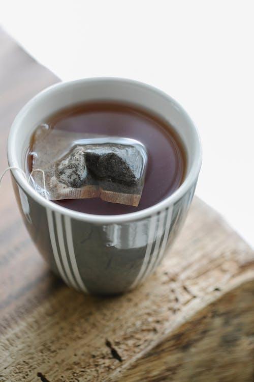 Mug of tea on wooden surface