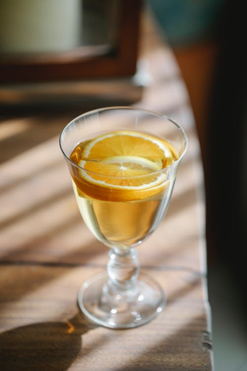 Alcoholic cocktail with orange in glass