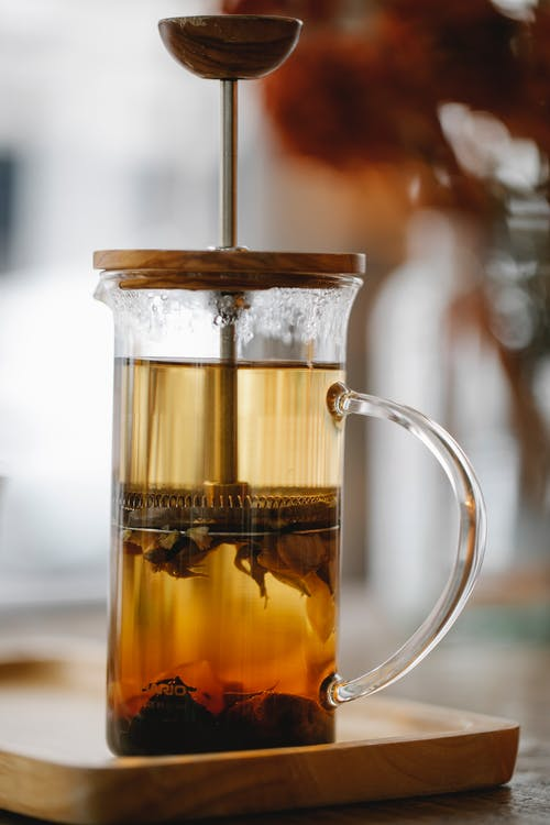 Glass French press teacup with brewing aromatic tea