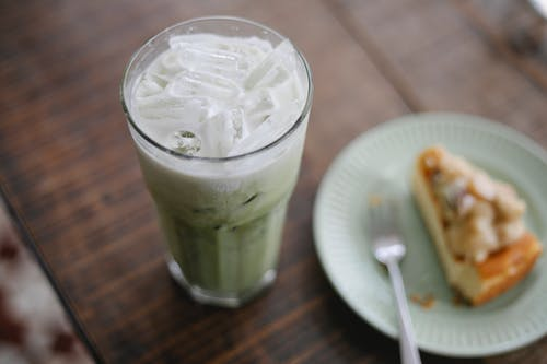 Tasty iced matcha latte served with sweet pie