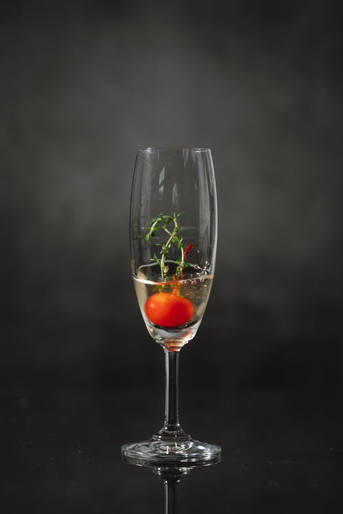 Glass of cocktail with cherry
