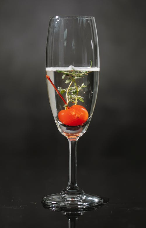 Glass of drink with cherry
