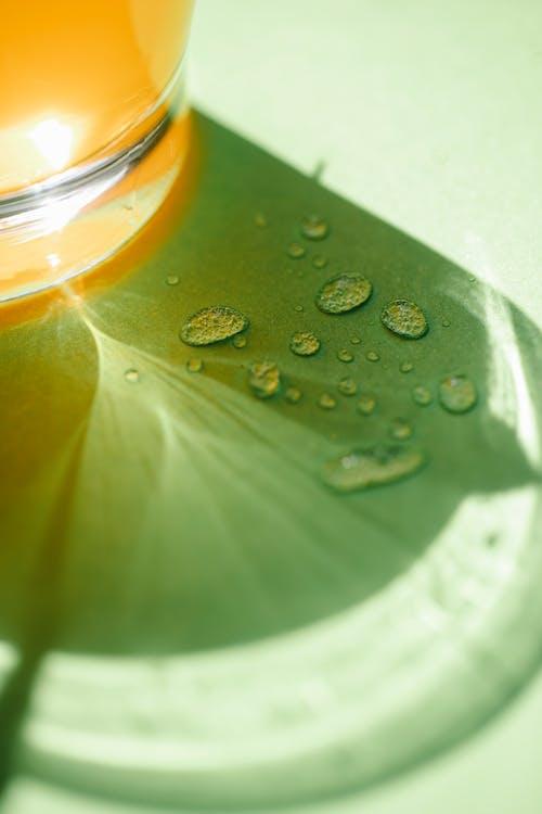 Water drops near glass of drink