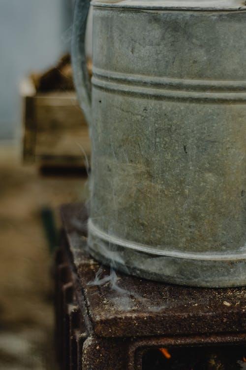 Gray Metal Bucket on Brown Wooden Table
