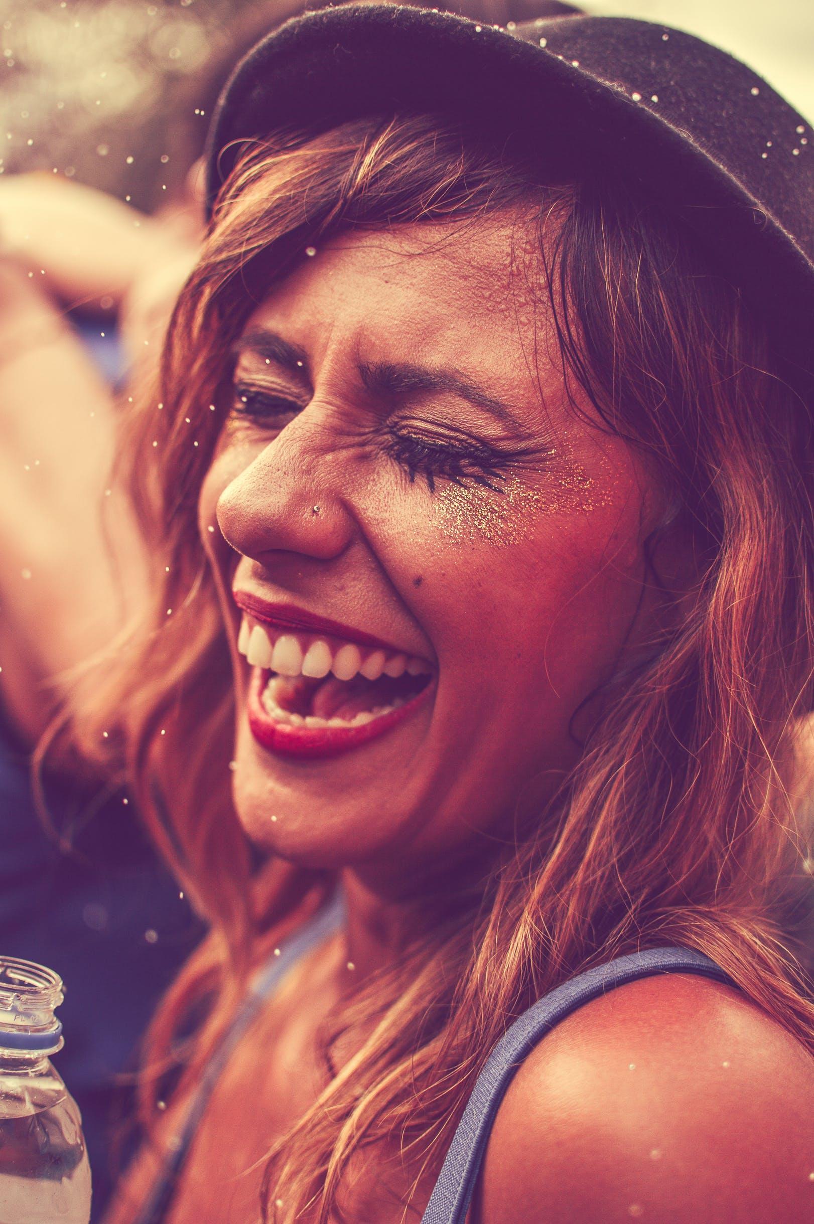 Laughing Woman Wearing Blue Tank Top