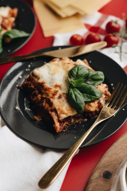 Baked Lasagna on a Black Plate