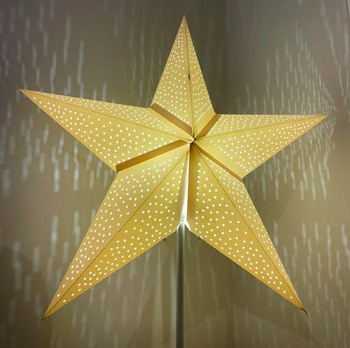 Gold Star on Gray Surface