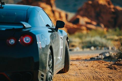 Black Porsche 911 on Brown Field