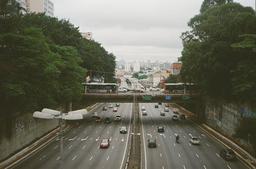 Busy road in megapolis in summer day