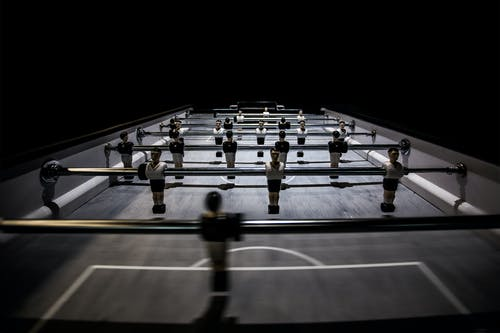 Selective Focus Photography of Foosball Table
