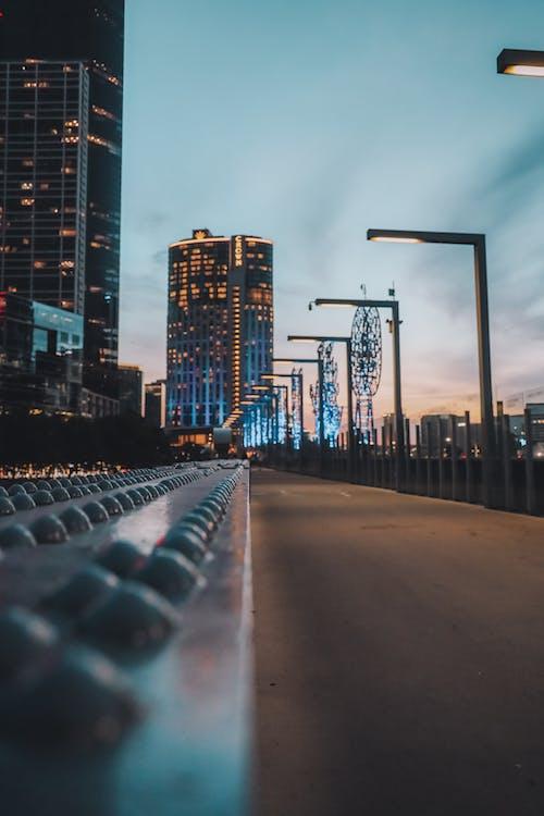 Black Metal Fence Near High Rise Buildings