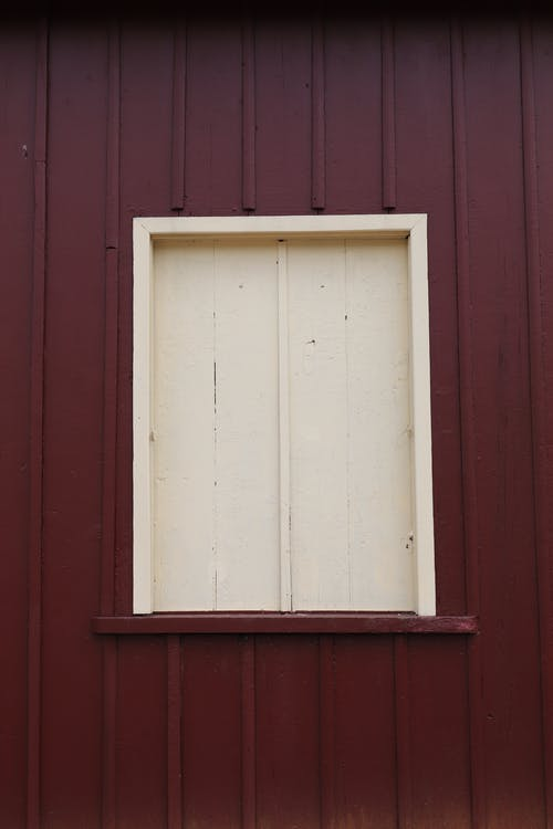 White Wooden Window Frame on Red Wall