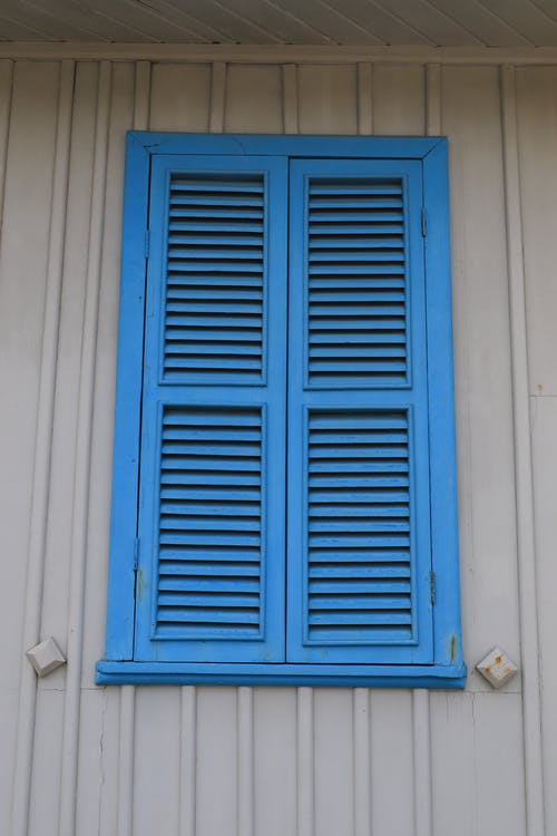 Blue Wooden Window on White Wall