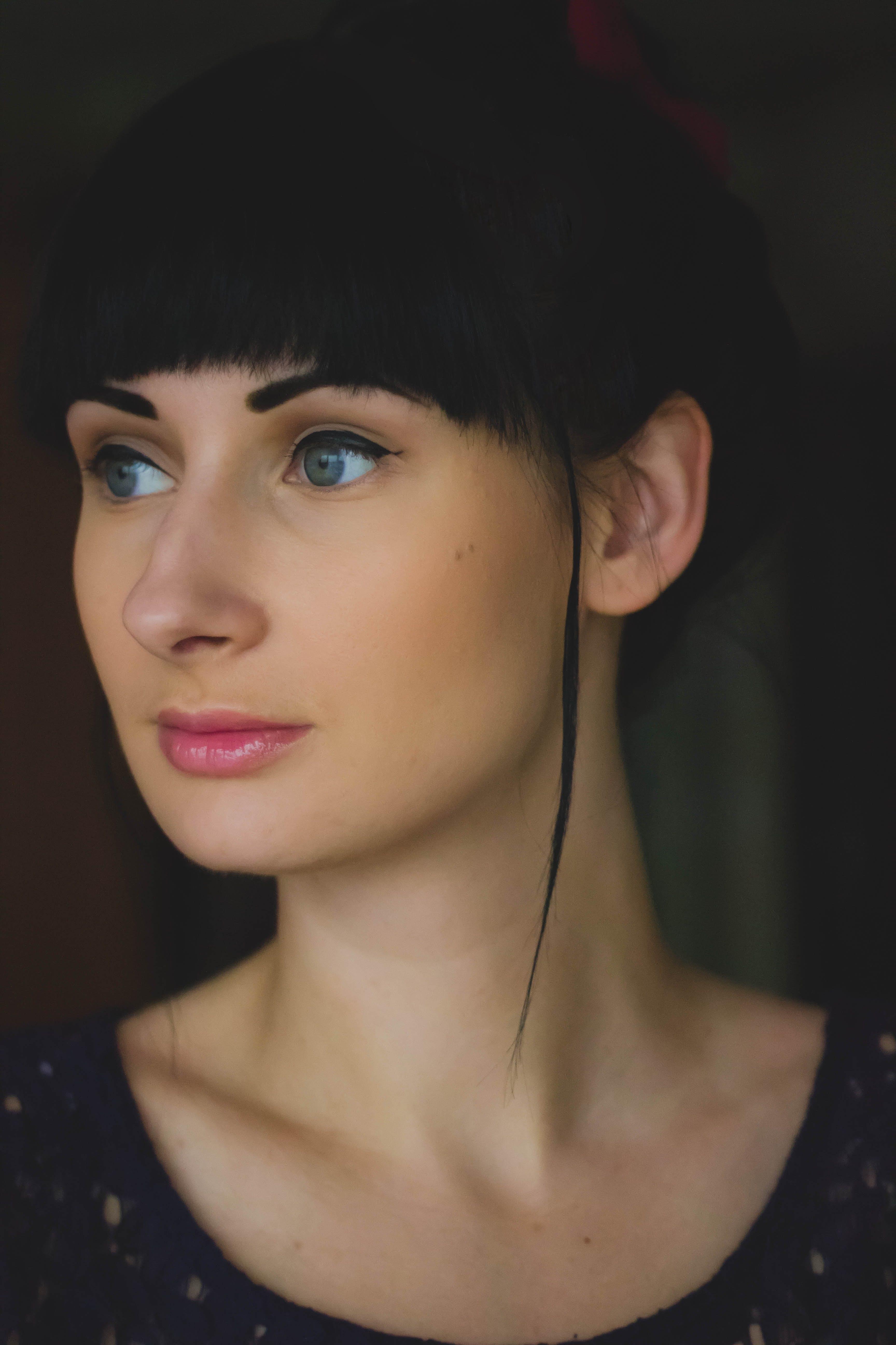 Woman Wearing Black Scoop Neck Shirt