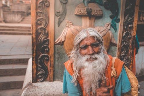 Elderly Hindu man with gray beard in town